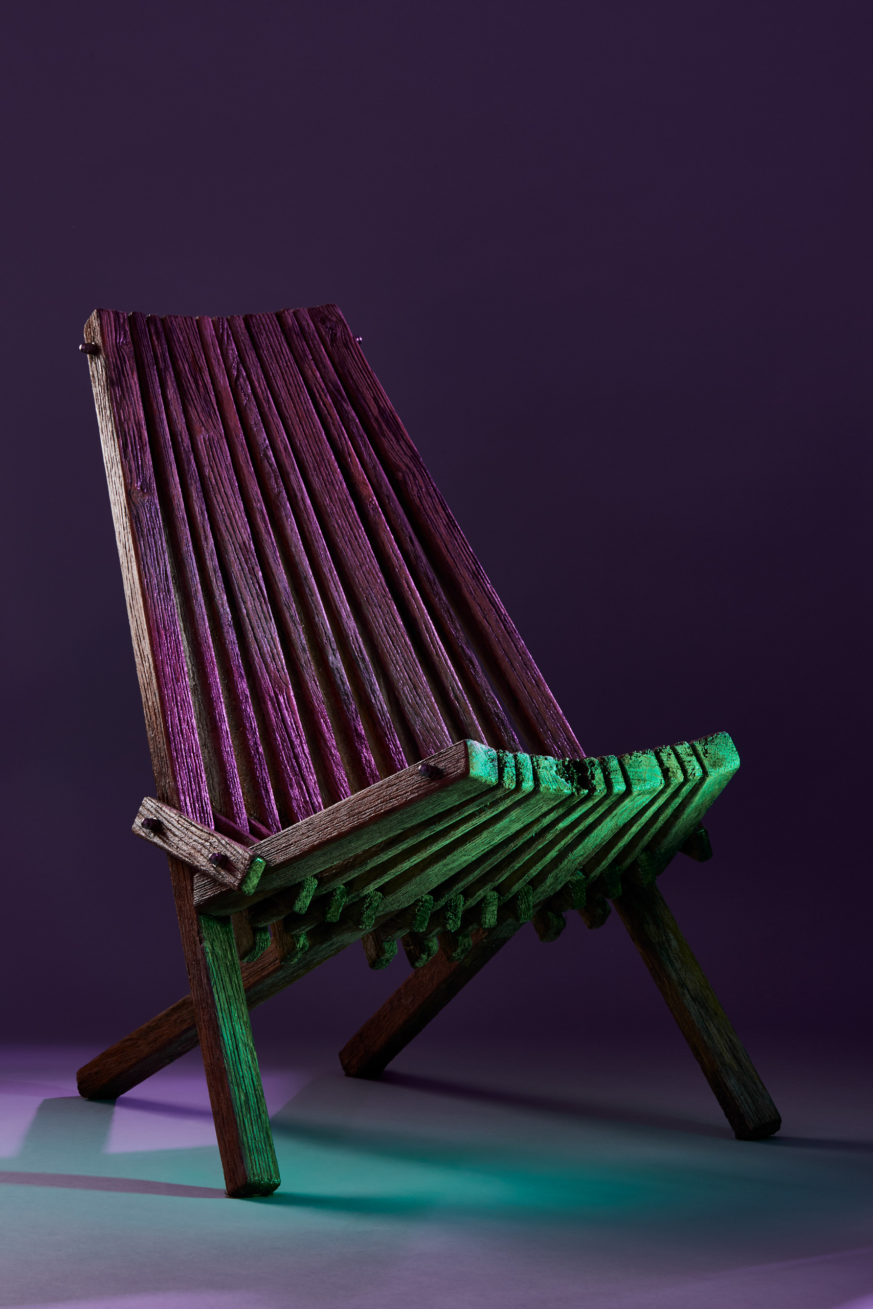 Wooden chair in purple green light